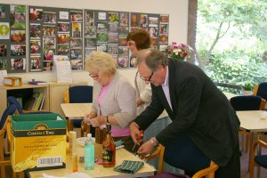 Pam, Charles and Morag prepare the Tombola