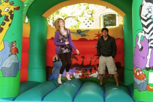 Jenny and Joe warm-up the bouncy castle