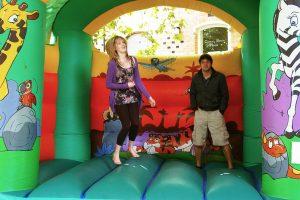 Jenny and Joe warm-up the bouncy castle