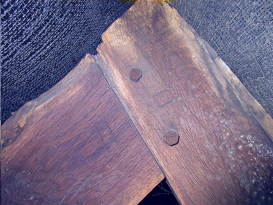 The massive oak beams and the carpenters pegs and markings