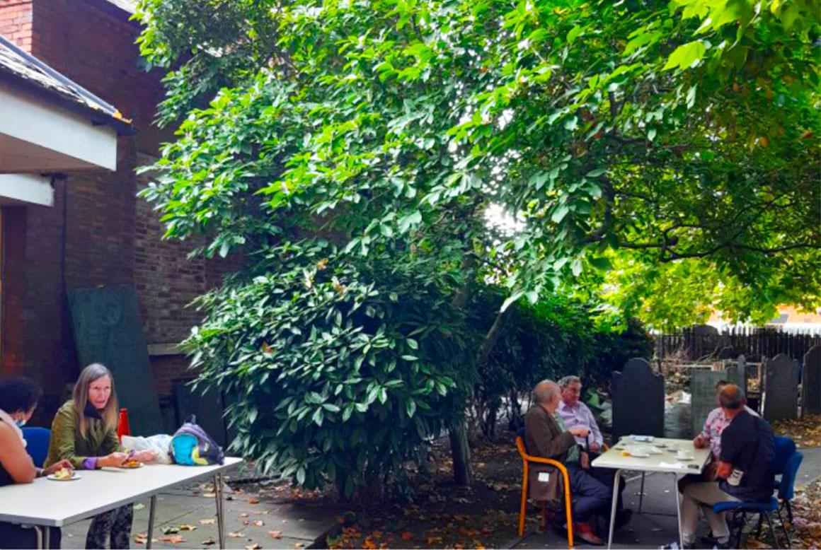 Visitors enjoying refreshments in the garden